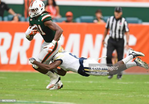 Georgia Tech defensive back Step Durham tackles University of Miami wide receiver Darrell Langham during an NCAA football game between the Georgia...
