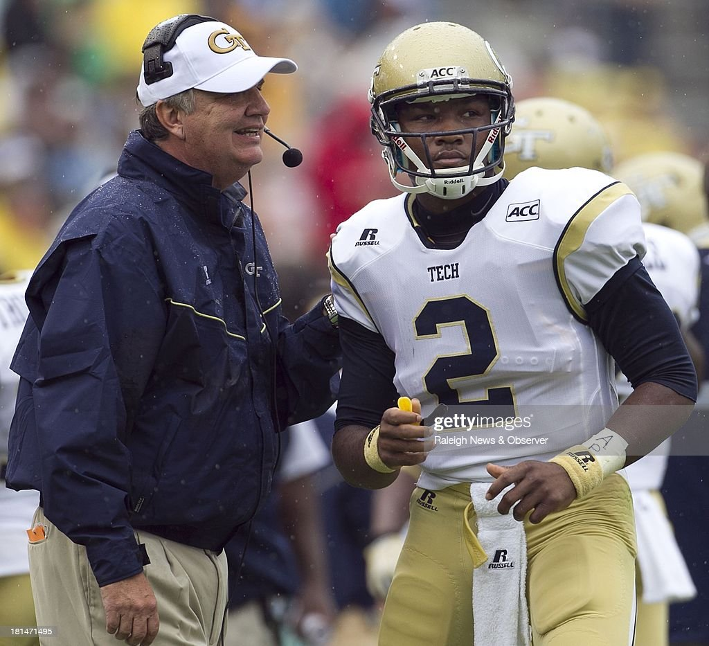 Georgia Tech head coach Paul Johnson confers with quarterback Vad Lee (2) during the second quarter against North Carolina at Bobby Dodd Stadium in Atlanta, Georgia, on Saturday, September 21, 2013. The Georgia Tech Yellow Jackets defeated the North Carolina Tar Heels, 28-20.