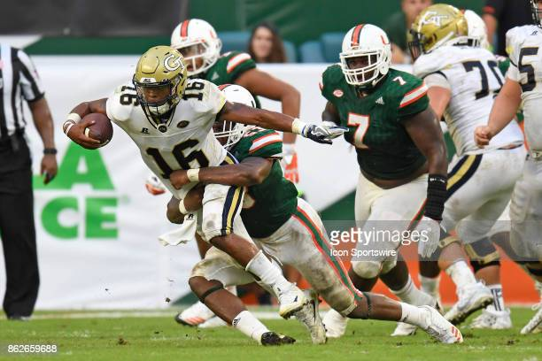 Georgia Tech quarterback TaQuon Marshall is tackled by University of Miami linebacker Zach McCloud during an NCAA football game between the Georgia...