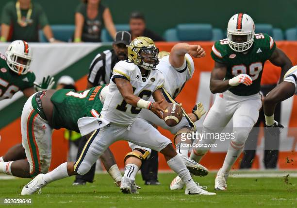 Georgia Tech quarterback TaQuon Marshall pitches out during an NCAA football game between the Georgia Tech Yellow Jackets and the University of Miami...