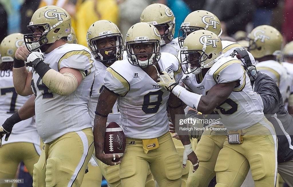 Georgia Tech's Louis Young (8) celebrates with teammates after intercepting a pass in the fourth quarter against North Carolina at Bobby Dodd Stadium in Atlanta, Georgia, on Saturday, September 21, 2013. The Georgia Tech Yellow Jackets defeated the North Carolina Tar Heels, 28-20.