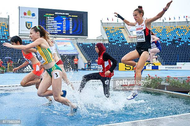Georgia Winkcup from Australia and Marwa Bouzayani from Tunisia and Charlotte Prouse from Canada compete in women's 3000 meters qualification during...