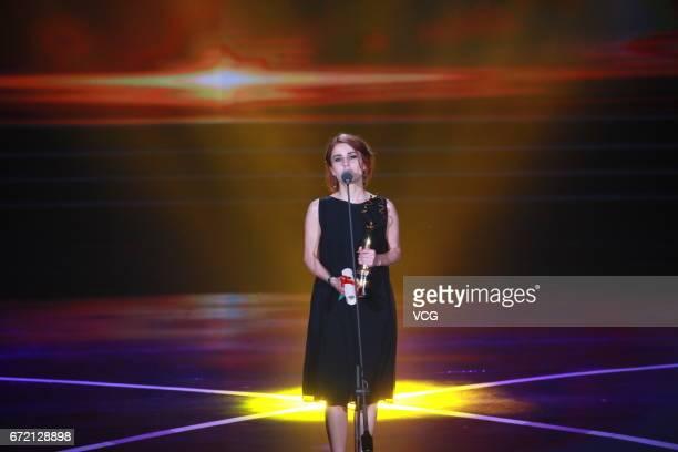 Georgian actress Liya Capanadze wins the best supporting actress award of Tiantan Award during the closing ceremony of 2017 Beijing International...