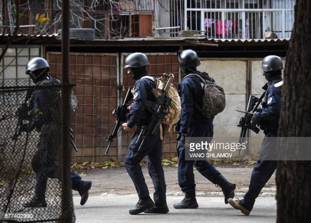 Georgian armed counterterrorist units move around an apartment block in Tbilisi on November 22 as part of a special operation Explosions and gunfire...