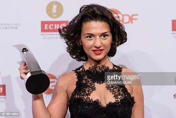 Georgian concert pianist Khatia Buniatishvili poses with her trophy after she was given the Echo Klassik 2016 classical music award on October 9 2016...