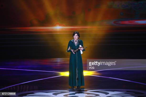 Georgian director Rusudan Glurjidze wins the best director award of Tiantan Award during the closing ceremony of 2017 Beijing International Film...