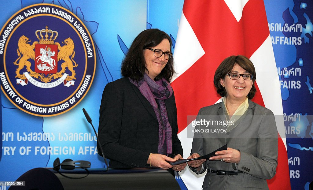 Georgian Foreign Minister Maia Panjikidze (R) and EU Commissioner for Home Affairs Cecilia Malmstrom smile at their joint press conference in Tbilisi, on February 25, 2013. EU Commissioner for Home Affairs handed in the action plan in the framework of visa dialogue to Georgia's Foreign Minister, the Georgian media reported today.