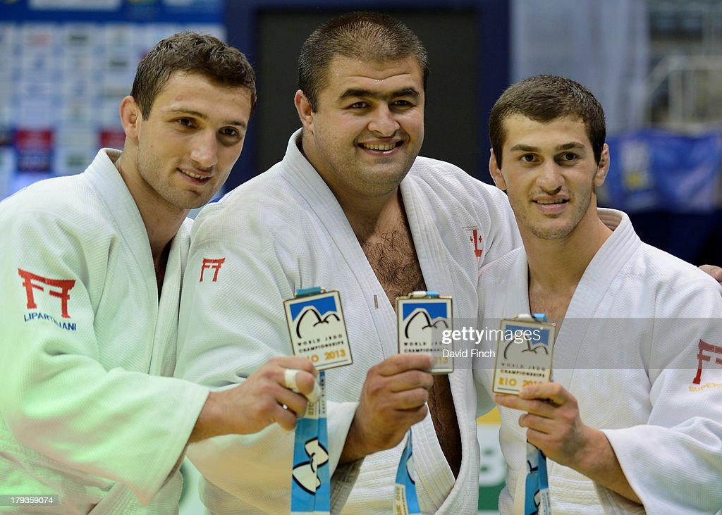 Georgian gold medal winning team members (L-R) Varlam Liparteliani, Adam Okruashvili and Avtandili Tchrikishvili after the medal ceremony at the Rio World Judo Team Championships on Day 7 on September 01, 2013 at the Gympasium Maracanazinho in Rio de Janeiro, Brazil.