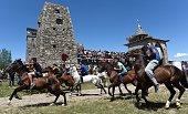 TOPSHOT Georgian men ride horses during a folk festival near the Bazaleti lake some 50km from Tbilisi Georgia on July 9 2016 / AFP / VANO SHLAMOV