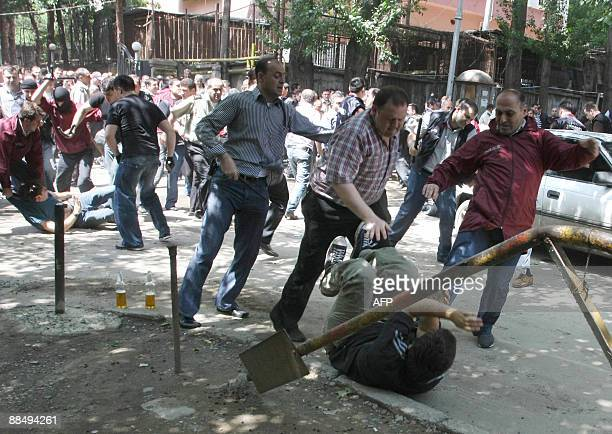Georgian police clash with opposition protestors in Tbilisi on June 15 2009 Georgian police wielding batons violently dispersed several dozen...