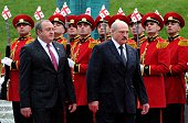 Georgian President Giorgi Margvelashvili and his Belarus' counterpart Alexander Lukashenko review an honour guard during a welcoming ceremony in...