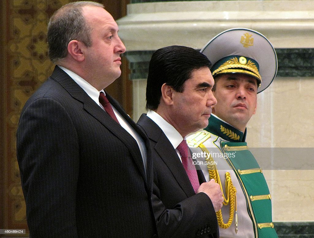 Georgian President <a gi-track='captionPersonalityLinkClicked' href=/galleries/search?phrase=Giorgi+Margvelashvili&family=editorial&specificpeople=10916956 ng-click='$event.stopPropagation()'>Giorgi Margvelashvili</a> (L) and his Turkmen counterpart Gurbanguly Berdimuhamedov (C) listen to their national anthems during a welcoming ceremony in Ashgabat on December 15, 2014. AFP PHOTO / IGOR SASIN