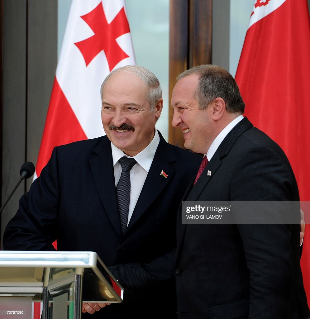 Georgian President <a gi-track='captionPersonalityLinkClicked' href=/galleries/search?phrase=Giorgi+Margvelashvili&family=editorial&specificpeople=10916956 ng-click='$event.stopPropagation()'>Giorgi Margvelashvili</a> (R) shakes hands with his Belarus' counterpart <a gi-track='captionPersonalityLinkClicked' href=/galleries/search?phrase=Alexander+Lukashenko&family=editorial&specificpeople=542572 ng-click='$event.stopPropagation()'>Alexander Lukashenko</a> after a joint press conference in Tbilisi on April 23, 2015. <a gi-track='captionPersonalityLinkClicked' href=/galleries/search?phrase=Alexander+Lukashenko&family=editorial&specificpeople=542572 ng-click='$event.stopPropagation()'>Alexander Lukashenko</a> is on his official visit to Georgia.