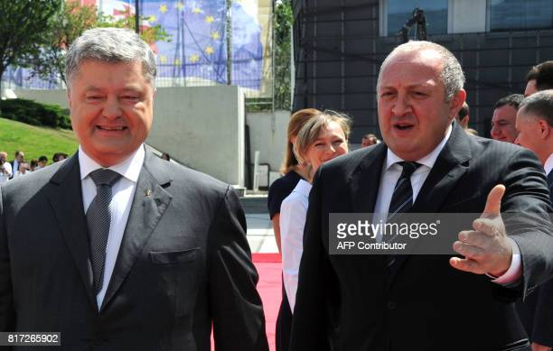 Georgian President Giorgi Margvelashvili welcomes his Ukrainian counterpart Petro Poroshenko in Tbilisi on July 18 during an official visit to...