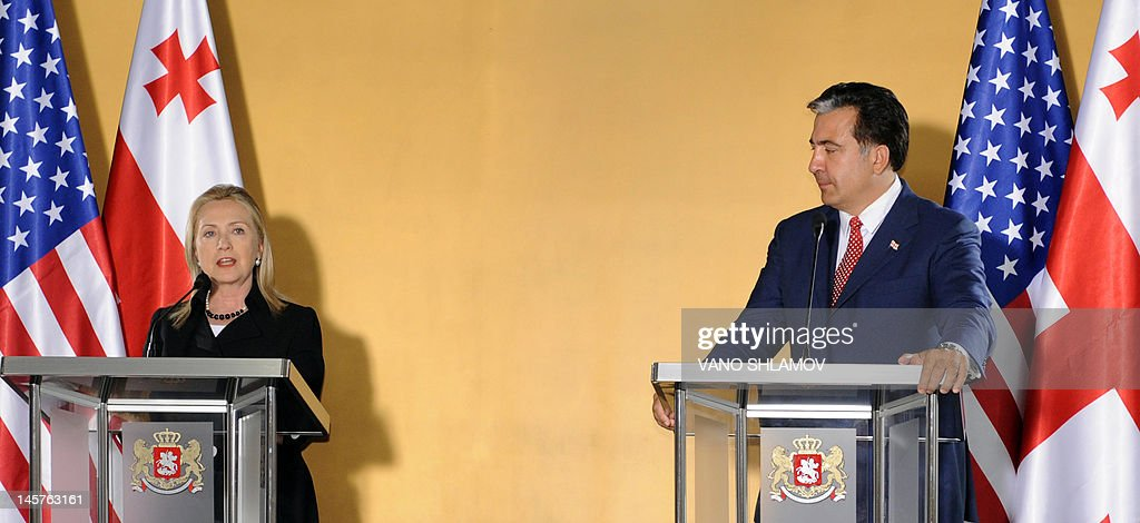 Georgian President Mikheil Saakashvili (R) and US Secretary of State Hillary Clinton take part in a press conference at the Public Service Hall in Batumi, Georgia, on June 5, 2012. AFP PHOTO / VANO SHLAMOV