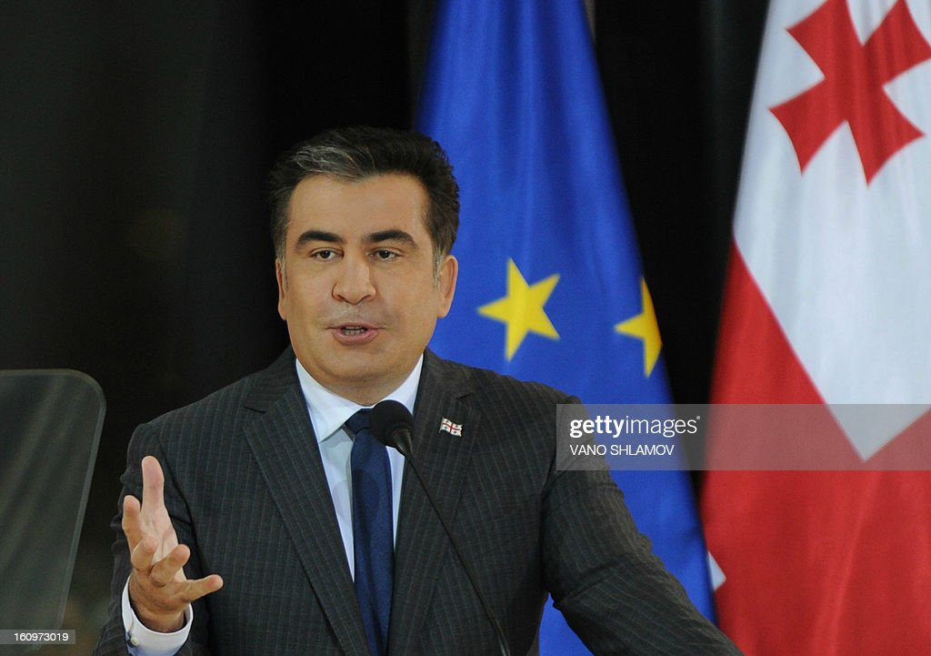 Georgian President Mikheil Saakashvili speaks in Tbilisi , on February 8, 2013. An angry crowd of around 300 protesters aimed today punches and kicks at the mayor of Tbilisi and several lawmakers from Saakashvili's party in the Georgian capital, hours before the president was to give his annual state of the nation address. AFP PHOTO / VANO SHLAMOV