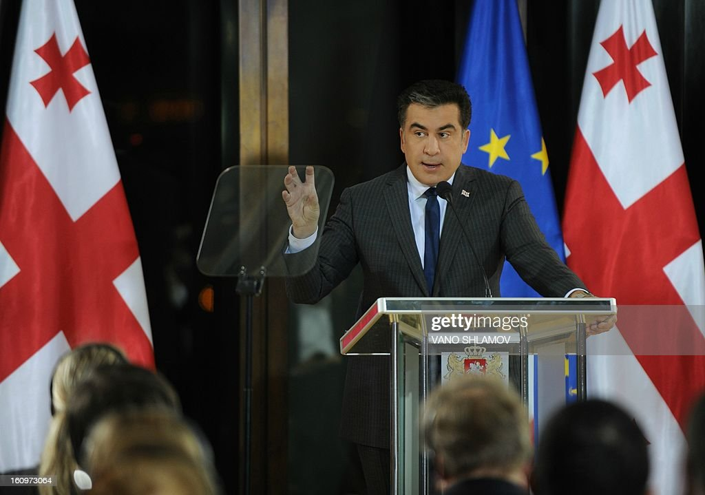 Georgian President Mikheil Saakashvili speaks in Tbilisi , on February 8, 2013. An angry crowd of around 300 protesters aimed today punches and kicks at the mayor of Tbilisi and several lawmakers from Saakashvili's party in the Georgian capital, hours before the president was to give his annual state of the nation address.