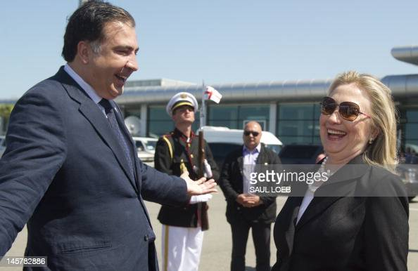 Georgian President Mikheil Saakashvili speaks with US Secretary of State Hillary Clinton on June 6 2012 at Batumi International Airport in Batumi...