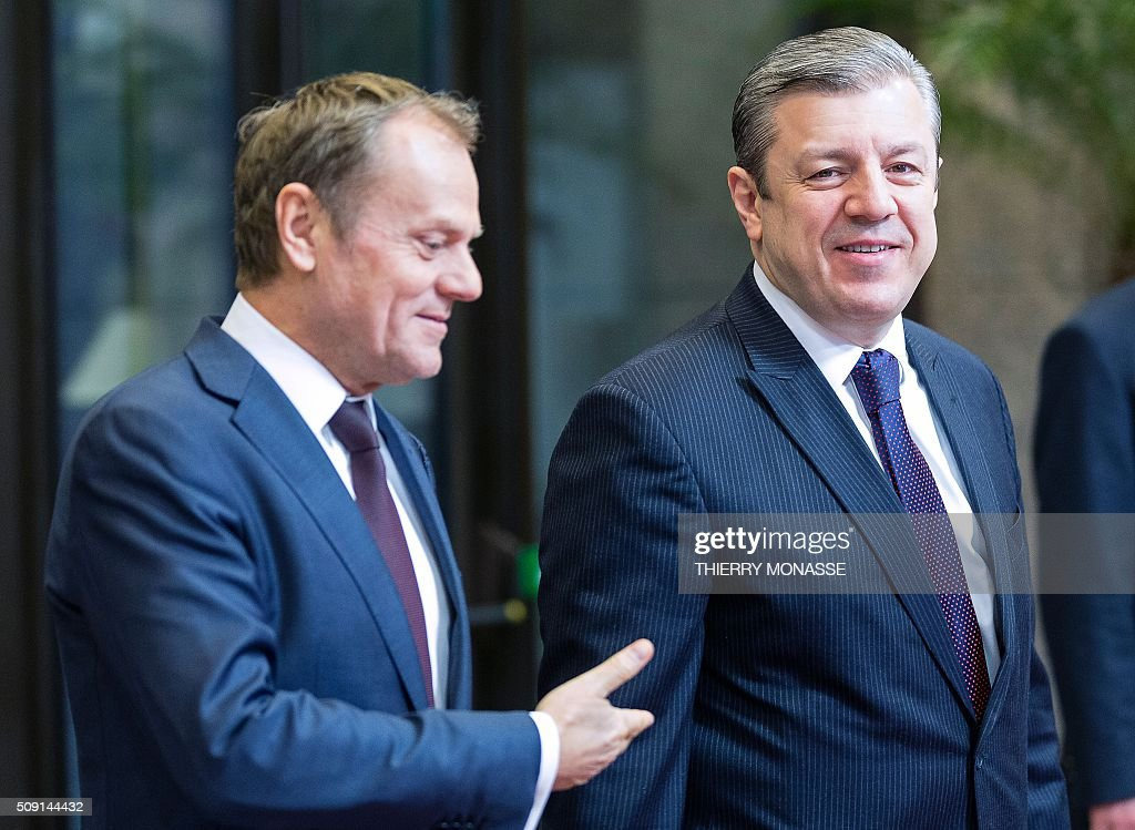 Georgian Prime Minister Giorgi Kvirikashvili (R) is welcomed by European Council President Donald Tusk (L) prior to a bilateral meeting at the European Council headquarters in Brussels on February 9, 2016. AFP PHOTO / THIERRY MONASSE / AFP / THIERRY MONASSE