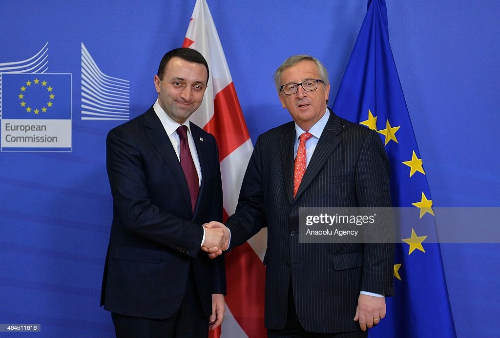 Georgian Prime Minister <a gi-track='captionPersonalityLinkClicked' href=/galleries/search?phrase=Irakli+Garibashvili&family=editorial&specificpeople=11579652 ng-click='$event.stopPropagation()'>Irakli Garibashvili</a> (L) and President of the European Commission <a gi-track='captionPersonalityLinkClicked' href=/galleries/search?phrase=Jean-Claude+Juncker&family=editorial&specificpeople=207032 ng-click='$event.stopPropagation()'>Jean-Claude Juncker</a> (R) shake hands before a meeting in Brussels, Belgium on February 26, 2015.