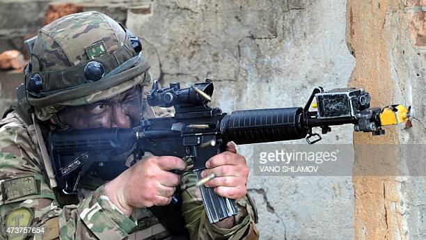 A Georgian soldier looks down the scope of his M4 assault rifle as he takes part in the joint USGeorgia military exercise Noble Partner 2015 at the...
