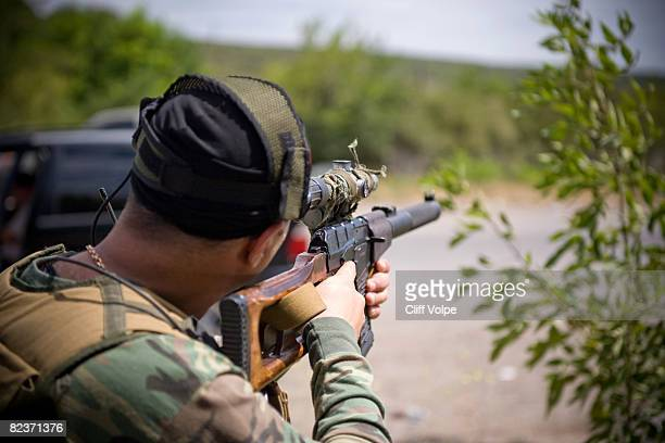 Georgian special forces soldier aims a rifle August 15 2008 near Gori Georgia US Secretary of State Condoleezza Rice arrived in Tbilisi today to show...