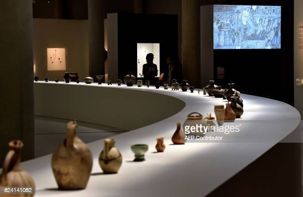 Georgian wine carafes dating from several different eras sit on display at an exhibition at The Cité du Vin in Bordeaux on July 28 2017 Georgia said...