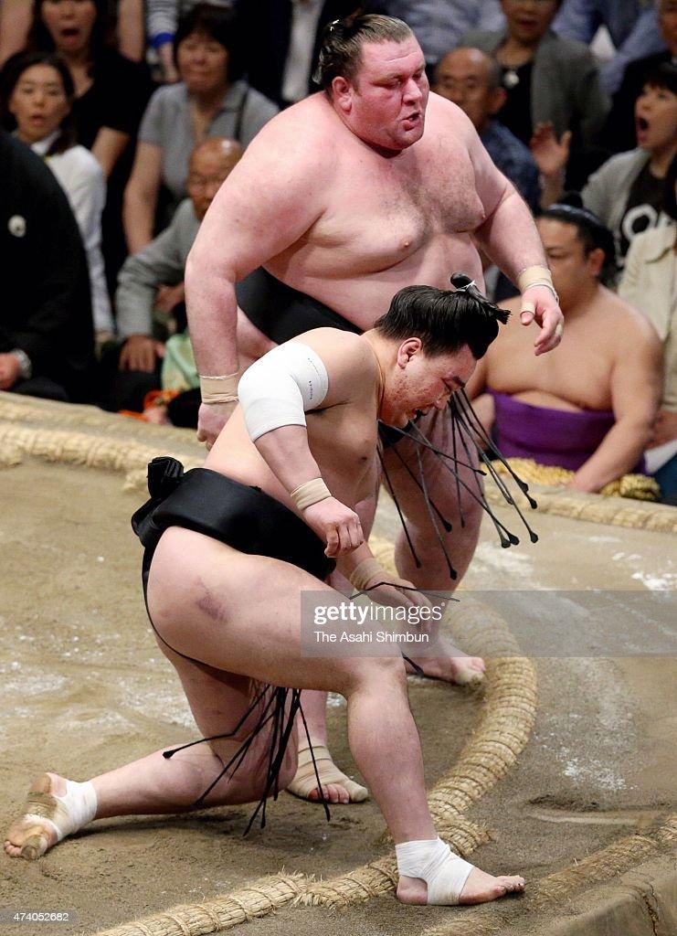 Georgian wrestler Gagamaru reacts after beating Mongolian yokozuna Harumafuji during day ten of the Grand Sumo Summer Tournament at Ryogoku Kokugikan...