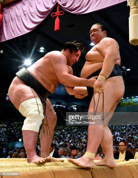 Georgian wrestler Tochinoshin pushes yokozuna Kisenosato out of the ring to win during day three of the Grand Sumo Nagoya Torunament at Aichi...