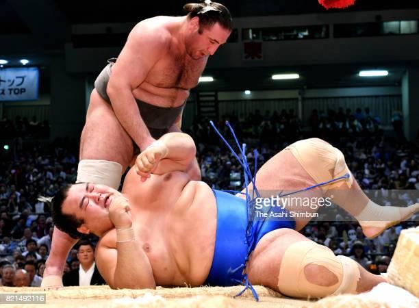 Georgian wrestler Tochinoshin throws komusubi Kotoshogiku to win during day fourteen of the Grand Sumo Nagoya Torunament at Aichi Prefecture...