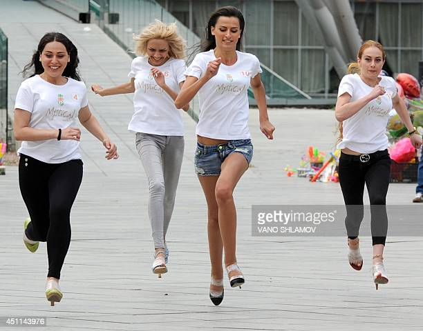 Georgian young women run a 50 metre race in high heels in Tbilisi on June 24 2014 To participate in the race women must wear heels 7 cm tall AFP...