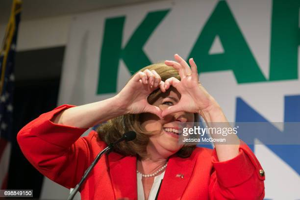 Georgia's 6th Congressional district Republican candidate Karen Handel gives a heart sign to supporters gathered at Hyatt Regency at Villa Christina...