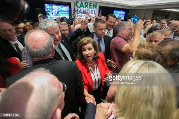 Georgia's 6th Congressional district Republican candidate Karen Handel shakes hands with supporters after giving a victory speech at the Hyatt...