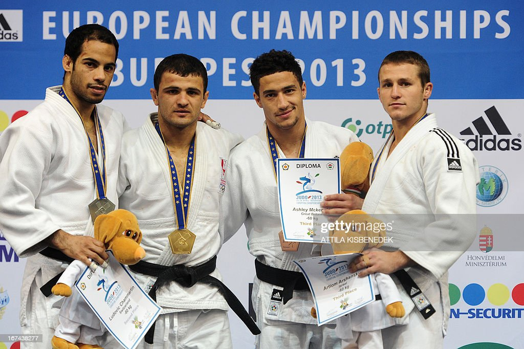 Georgia's Amiran Papinashvili (2nd L) celebrates his gold medal on the podium with silver medalist Switzerland's Ludovic Chammartin (L) and bronze medalists, Israel's Artiom Arshansky (R) and Ashley McKenzie (2nd R) during the medal ceremony of the Judo European Championships in 60kg category for men in Budapest.