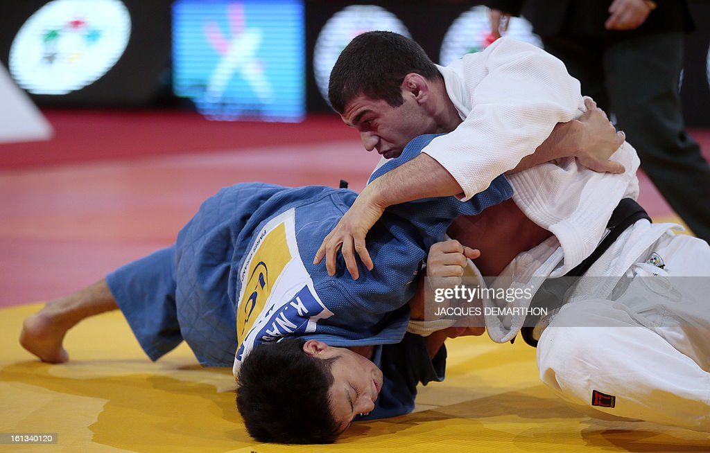 Georgia's Avtandil Tchrikishvili (R) fights against Japan's Nagashima Keita on February 10, 2013 in the men's 81kg category semi-finals during the Paris International Judo tournament, part of the Grand Slam, at the Palais Omnisports de Paris-Bercy (POPB). AFP PHOTO / JACQUES DEMARTHON