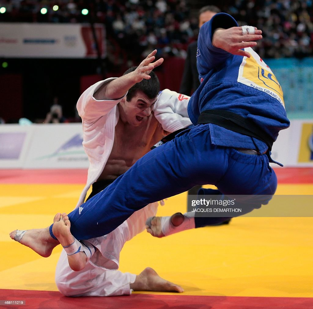 Georgia's Avtandili Tchrikishivili competes with France's Loic Pietri during the men's 81kg final at the 2014 Paris Judo Grand Slam tournament on...