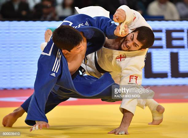 Georgia's Avtandili Tchrikishvili and South Korea's Lee Seungsu compete in the men's 81kilogram category final match at the Judo Grand Slam Tokyo on...