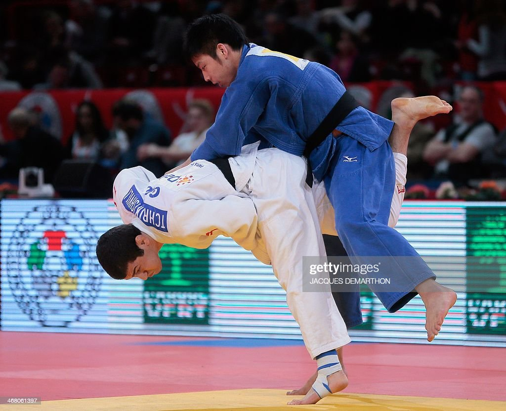 Georgia's Avtandili Tchrikishvili competes with Japan's Nagase Takanori during the men's 81kg quarterfinals at the 2014 Paris Judo Grand Slam...