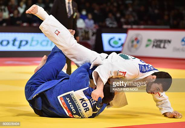 Georgia's Avtandili Tchrikishvili pushes down South Korea's Lee Seungsu in the men's 81kilogram category final match at the Judo Grand Slam Tokyo on...