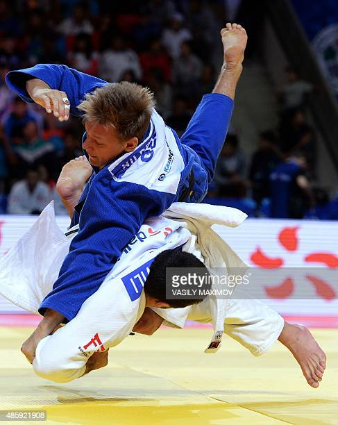 Georgia's Beka Gviniashvili competes with Germany's Aaron Hildebrand during the men's team bronze medal match at the Judo World Championships in...