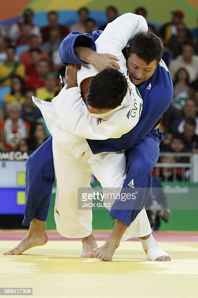 Georgia's Beka Gviniashvili competes with Great Britain's Benjamin Fletcher during their men's 100kg judo contest match of the Rio 2016 Olympic Games...