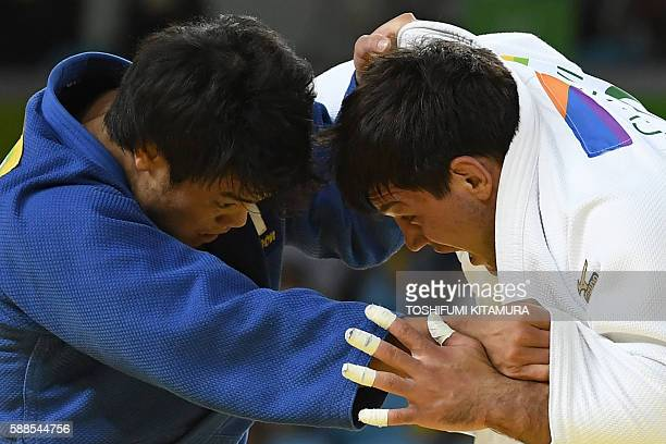 Georgia's Beka Gviniashvili competes with Japan's Ryunosuke Haga during their men's 100kg judo contest repechage match of the Rio 2016 Olympic Games...
