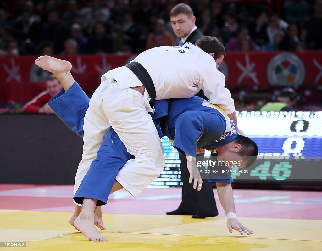 Georgia's David Loriashvili (white) fights against Japan's Kumashiro Yusuke on February 10, 2013, during the Men -100kg eliminatories of the Paris International Judo tournament, part of the Grand Slam, at the Palais Omnisports de Paris-Bercy (POPB) in Paris. AFP PHOTO/JACQUES DEMARTHON