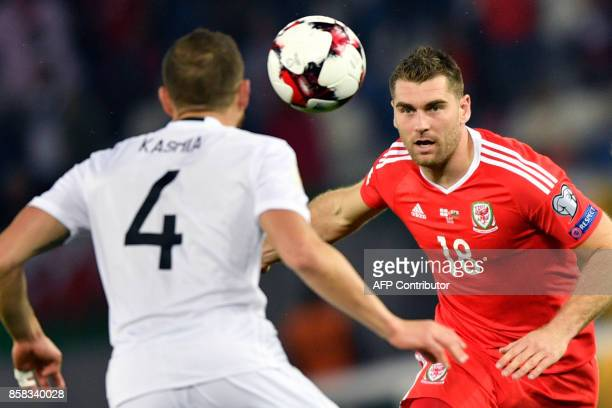 Georgia's defender Guram Kashia and Wales' striker Sam Vokes vie for the ball during the FIFA World Cup 2018 qualification football match between...