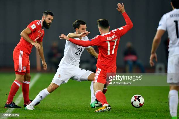 Georgia's defender Otar Kakabadze and Wales' midfielder Tom Lawrence vie for the ball during the FIFA World Cup 2018 qualification football match...