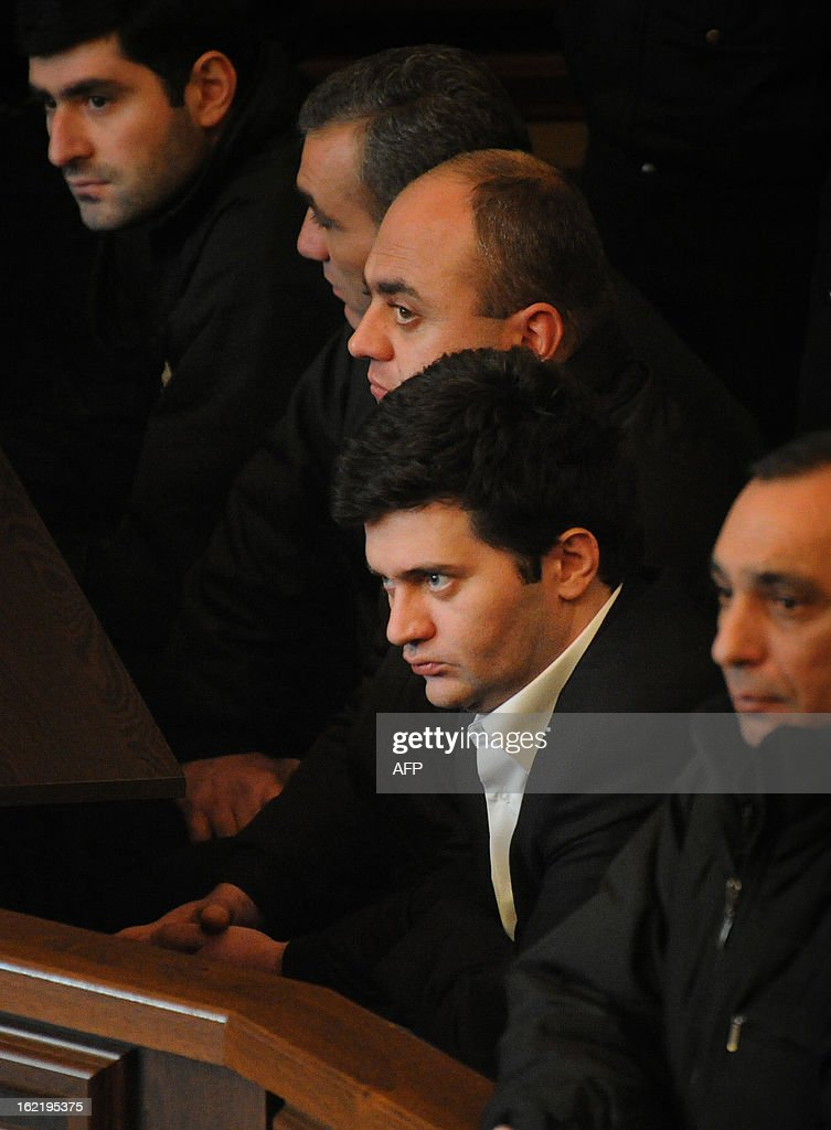 Georgia's former defense, prison and interior minister Bacho Akhalaia sits in a court room in the capital Tbilisi, on February 20, 2013. Tbilisi City Court held today pretrial hearing in the case against President Mikheil Saakashvili's loyalist Bacho Akhalaia and other former government officials, the Georgian media reported. AFP PHOTO / POOL / IRAKLI GEDENIDZE