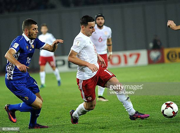 Georgia's forward Giorgi Chanturia challenges Moldova's defender Vadim Bolohan during the 2018 World Cup European zone group D qualifying football...