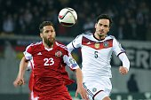 Georgia's forward Levan Mchedlidze vies for the ball with Germany's defender Mats Hummels during the Euro 2016 qualifying football match between...