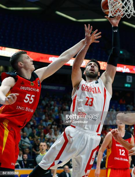Georgia's forward Tornike Shengelia attempts a shot as he is marked by Germany's center Isaiah Hartenstein during their FIBA EuroBasket 2017...