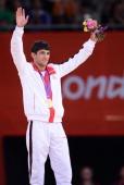 Georgia's gold medalist Lasha Shavdatuashvili celebrates on the podium of the men's 66kg contest of the judo event at the London 2012 Olympic Games...